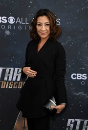 Michelle Yeoh arrived for the premiere of 'Star Trek: Discovery' carrying a shiny black hard-case clutch.