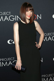 Bryce Dallas Howard went for subdued elegance with this navy satin tube clutch and black evening dress combo at the Project Imaginat10n Film Festival.