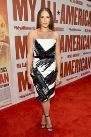 Amanda Righetti was sleek and elegant in a strapless black-and-white dress during the premiere of 'My All American.'