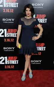 Cobie Smulders brightened her navy dress with a canary yellow box clutch and turquoise sandals.