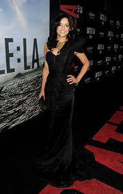 Michelle Rodriguez accented her dramatic black gown with Kelly Locke's Mini Bardot clutch with covered studs in black matte fishskin with gold metallic trim.