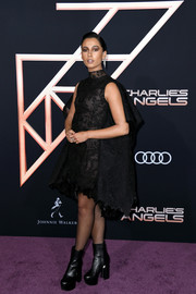 Naomi Scott went for super-edgy styling with chunky black ankle boots by Givenchy.