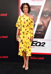 Gina Torres matched her footwear with a nude frame clutch.
