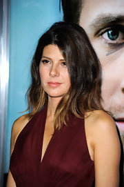 At 'The Ides of March' premiere Marisa Tomei's cool, choppy 'do was ultra casual. To get her textured waves, try spritzing on a product like ALTERNA Summer Hair Ocean Waves Texturizing Spray.