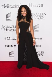 Meagan Good made a dramatic entrance in a black Gemy Maalouf jumpsuit with lace panels and a long train at the premiere of 'Miracles from Heaven.'