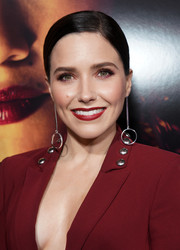 Sophia Bush swiped on some red lipstick to match her suit.