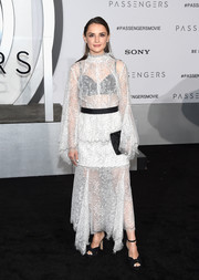 Rachael Leigh Cook went for some boho charm in a white maxi dress with a high neckline, bell sleeves, and a tonal floral pattern at the premiere of 'Passengers.'