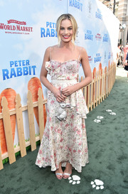 Margot Robbie was summer-chic in a floral corset dress by Brock Collection at the premiere of 'Peter Rabbit.'