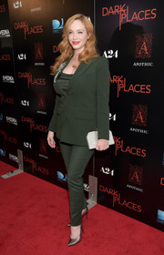 Christina Hendricks toughened up in an army-green pantsuit by Max Mara for the premiere of 'Dark Places.'