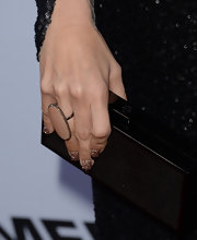 Ashley Tisdale added just a touch of glitz to her red carpet look with these glittery nails that featured a black tip.
