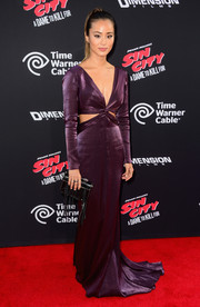 Jamie Chung oozed Old Hollywood glamour in a plum-colored Pamella by Pamella Roland cutout gown at the 'Sin City: A Dame to Kill For' premiere.