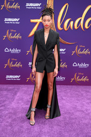 Willow Smith flashed her legs in a black Seen Users blazer with a long train at the premiere of 'Aladdin.'
