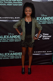 Skai Jackson toughened up her girly skirt with a camouflage-green zip-up jacket.