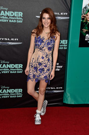 Dani Thorne went for a quirky finish with a pair of black-and-white checkered sneakers.