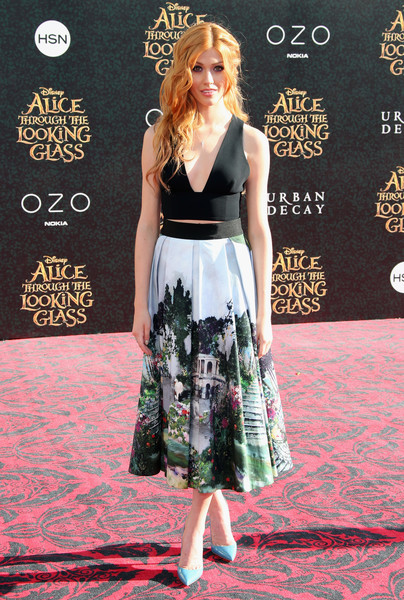 Katherine McNamara added an extra pop of color with a pair of sky-blue pumps by Christian Louboutin.