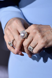 Celine Dion accessorized with a huge pearl ring along with some diamonds at the world premiere of 'Beauty and the Beast.'