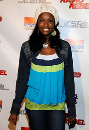 Coco Jones wore a severely cropped dark denim jacket with stonewashed details at the Premier of Disney Channel's 'Radio Rebel.'