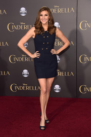 Heather McDonald attended the Hollywood premiere of 'Cinderella' wearing a super-short navy dress adorned with gold buttons.