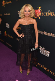 Kristin Chenoweth's iridescent python pumps totally popped against her black dress.