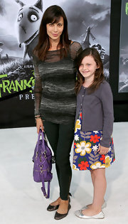 Catherine Bell kept it simple yet sexy at the premiere of 'Frankenweenie' with a sheer gray boatneck sweater.