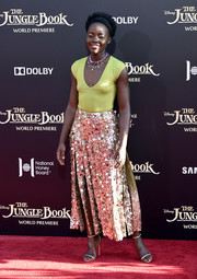 Lupita Nyong'o kept it laid-back up top in a low-cut chartreuse bodysuit by J. Crew at the premiere of 'The Jungle Book.'