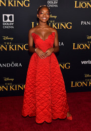 Marsai Martin matched her dress with red suede pumps.