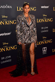 Beyonce Knowles got majorly blinged up in a heavily embellished jacket and sheer skirt combo by Alexander McQueen for the premiere of 'The Lion King.'