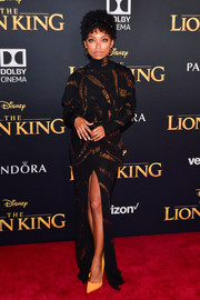 Logan Browning looked ultra sophisticated in a beaded black turtleneck gown by Prabal Gurung at the premiere of 'The Lion King.'