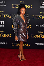 Skai Jackson channeled her inner glamazon in a silver Cong Tri tuxedo dress with statement sleeves at the premiere of 'The Lion King.'
