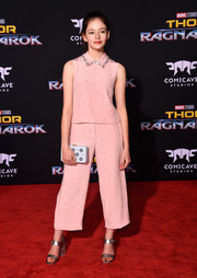 Mackenzie Foy styled her pink separates with chunky-heeled silver sandals.