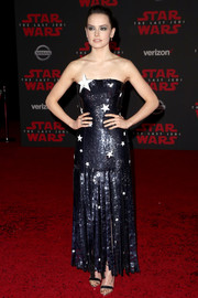 Daisy Ridley sealed off her enchanting look with silver Christian Louboutin sandals.