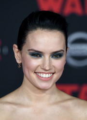 Daisy Ridley made her eyes pop with a heavy application of blue shadow.