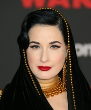 Dita Von Teese accessorized with layers of beaded necklaces to match the embellishments on her dress at the premiere of 'Star Wars: The Last Jedi.'