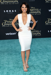 Becky G flaunted her shapely figure in a deep-V white bandage dress by House of CB at the premiere of 'Pirates of the Caribbean: Dead Men Tell No Tales.'