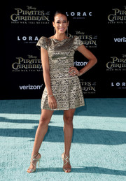 Dania Ramirez donned a gold cocktail dress with cap sleeves for the premiere of 'Pirates of the Caribbean: Dead Men Tell No Tales.'