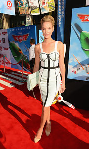 Ashley Scott went for a retro vixen look with this bustier-style white dress with black piping.