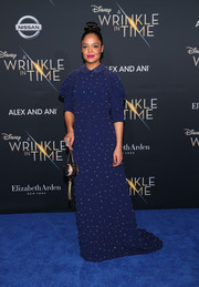 Tessa Thompson finished off her enchanting look with a beaded moon purse by Judith Leiber.