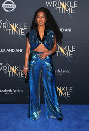 Angela Bassett matched her top with a pair of blue sequin palazzo pants.