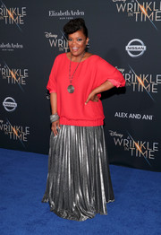 Yvette Nicole Brown glammed up her simple top with a pleated silver maxi skirt.