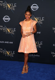 Yara Shahidi went the girly route in a shiny peach cocktail dress by Chanel at the premiere of 'A Wrinkle in Time.'