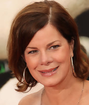 Marcia Gay Harden topped off her look with a retro-chic wavy 'do.