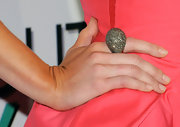 "Alice Eve showed off a decadent ring at the premiere of ""She's Out Of my League"". Her colossal ring stole the show and looked amazing next to her coral dress."