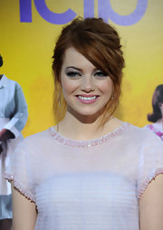 Emma Stone paired her haute Chanel frock with an equally chic messy updo.