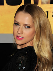 Teresa Palmer added a bubblicious pop of color to her sexy look with pink lipstick.