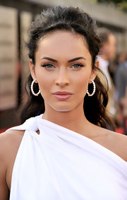 Megan Fox showed off her diamond hoop earrings while attending the premiere of 'Transformers'.