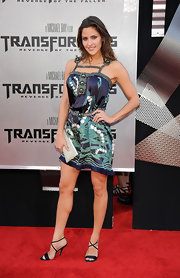 Jill Wagner looked summery in a navy and green tropical print dress with beaded embellishments.