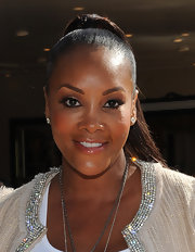 Vivica A. Fox kept her makeup soft and neutral with a sweep of pearly pink gloss at the 'Puss in Boots.' premiere. Her makeup artist Tai Young told us the fabulous look can be recreated using a combination of YSL Rouge Volupte #14 and Chanel #41 gloss.