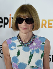 Anna Wintour framed her face with her usual bob for the premiere of 'Serena.'