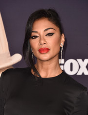 Nicole Scherzinger styled her hair into a bun with a loose tendril for the premiere of 'The Masked Singer.'