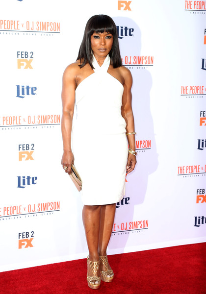 Angela Bassett went for a glamorous finish with gold platform sandals by Rene Caovilla.